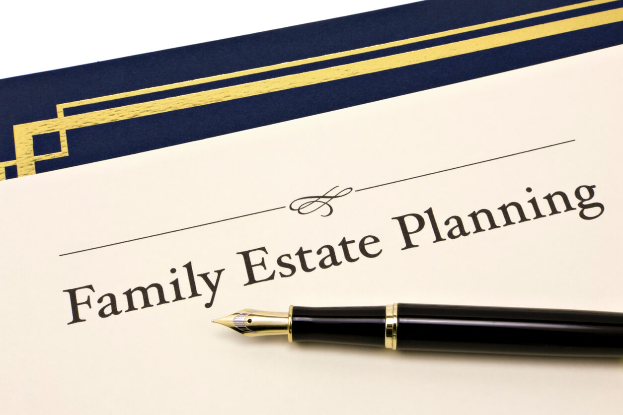 Image of a Family Estate Planning document and a pen